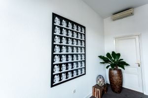 P = 42 x 7 x E (DO-disgust) framed in black frame on wall