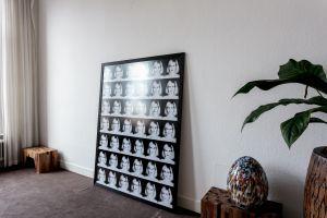 P = 42 x 7 x E (DO-disgust) framed in black frame on floor